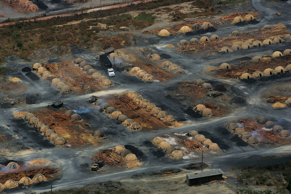 Aug. 22, 2005. Para State, Brazil. Rows of ovens used to produce charcoal out of rainforest wood. Forty percent of the timber extracted from the Amazon rainforest is used to produce charcoal for iron production. ©Daniel Beltra