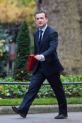 © Licensed to London News Pictures. 05/12/2017. London, UK. Secretary of State for Wales Alun Cairns arriving in Downing Street to attend a Cabinet meeting this morning.Yesterday, Brexit negotiations on the Northern Ireland border were stalled when Arlene Foster of the DUP said she could not support commitment to keep Northern Ireland aligned with EU laws. Photo credit : Tom Nicholson/LNP