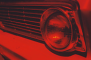 Automobile headlamp, red, abstract. 2000