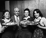 """Seafood Cook in Rosslare 07/05/1976.05/07/1976.7th May 1976.Pictured L-R, Siobhan Neeson, (15 years), 2nd prize, St. Louis Convent, Monaghan with her dish, """"Hot Peppered Cod"""",Mr. Tom Geoghagan, Market Development Manager, B.I.M.,Yvonne Cooney, (15 years), Dominican Convent, Muckross Park, Dublin, the winner with her dish, """"Cod Pancake Casserole"""", and Judy Tormey, (16) St. Joseph's College, Summerhill, Athlone, Co. Westmeath, 3rd prize, with her dish """"Devilled Cod"""""""