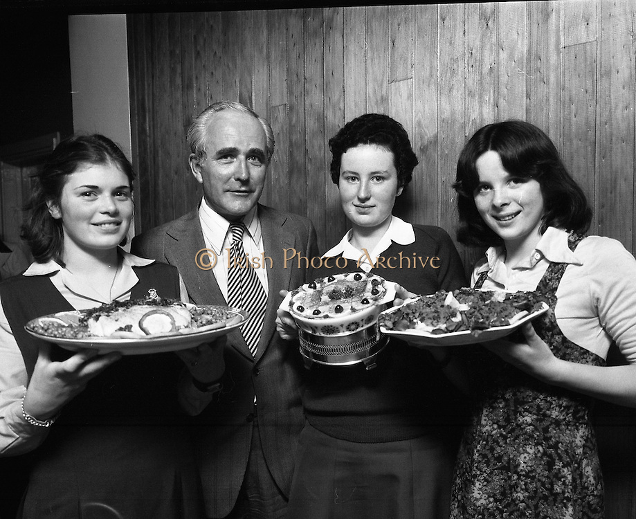 "Seafood Cook in Rosslare 07/05/1976.05/07/1976.7th May 1976.Pictured L-R, Siobhan Neeson, (15 years), 2nd prize, St. Louis Convent, Monaghan with her dish, ""Hot Peppered Cod"",Mr. Tom Geoghagan, Market Development Manager, B.I.M.,Yvonne Cooney, (15 years), Dominican Convent, Muckross Park, Dublin, the winner with her dish, ""Cod Pancake Casserole"", and Judy Tormey, (16) St. Joseph's College, Summerhill, Athlone, Co. Westmeath, 3rd prize, with her dish ""Devilled Cod"""