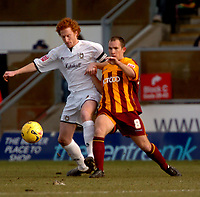 Photo: Ian Hebden.<br /> <br /> Milton Keynes v Bradford City. Coca Cola League 1. 25/02/2006.<br /> <br /> MK Dons Dean Lewington (L) is challenged by Bradfords Marc Bridge-Wilkinson (R).