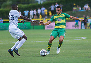 Tampa Bay Rowdies midfielder Leo Fernandes(11) and Swope Park Rangers defender Mark Segbers(43) battle for the ball during a USL soccer game, Sunday, May 26, 2019, in St. Petersburg, Fla. The Rowdies defeated the Rangers 1-0. (Brian Villanueva/Image of Sport)