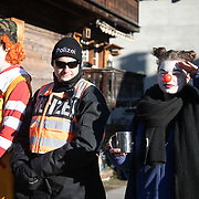 The second day of the Strike WEF march on Davos, 20th of January 2020, Switzerland. Two clowns from the Clown Army makes fun with a police officer. The clowns are activists who uses the clown character to spread fun and de-escalate potential tention. The march started in Schiers and walked the 24 kilomers to Klosters.  The aim is to finish in Davos with a public meeting in the town on the day the WEF begins. The march is a three day protest against the World Economic Forum meeting in Davos. The activists want climate justice and think that The WEF is for the world's richest and political elite only.