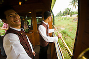 Eastern & Oriental Express. Stewards and passengers enjoy the fresh breeze at the Observation Car.