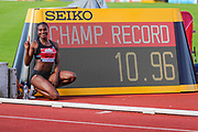 Dina ASHER-SMITH poses next to her winning time after the Women's 100m Final during the Muller British Athletics Championships at Alexander Stadium, Birmingham, United Kingdom on 24 August 2019.