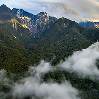 The highest peak in Borneo, Mount Kinabalu stands at 4095 meters in elevation and is an epicenter for biodiversity in the region. Here viewed from the northern side, the upper slopes are marred with landslips caused during the 2015 earthquake.