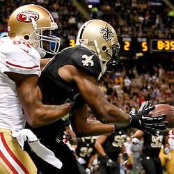 November 25, 2012; New Orleans, LA, USA; San Francisco 49ers wide receiver Randy Moss (84) breaks up an interception in the endzone by New Orleans Saints free safety Malcolm Jenkins (27) during the second half of a game at the Mercedes-Benz Superdome. The 49ers defeated the Saints 31-21. Mandatory Credit: Derick E. Hingle-US PRESSWIRE