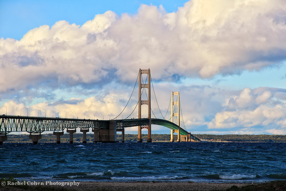 &quot;Mackinac Bridge&quot;-1<br /> <br /> A wonderful view of the beautiful Mackinac Bridge as viewed from Mackinaw City. Mackinac Bridge along with lovely puffy clouds and deep blue waters, combine to make a fantastic image!!<br /> <br /> Mackinac Bridge by Rachel Cohen