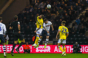 Pontus Jansson of Leeds United (18) heads above Sean Maguire of Preston North End (24) during the EFL Sky Bet Championship match between Preston North End and Leeds United at Deepdale, Preston, England on 9 April 2019.