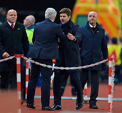 STOKE-ON-TRENT, ENGLAND - Monday, April 18, 2016: Tottenham Hotspur's manager Mauricio Pochettino and Stoke City's manager Mark Hughes after the FA Premier League match at the Britannia Stadium. (Pic by David Rawcliffe/Propaganda)