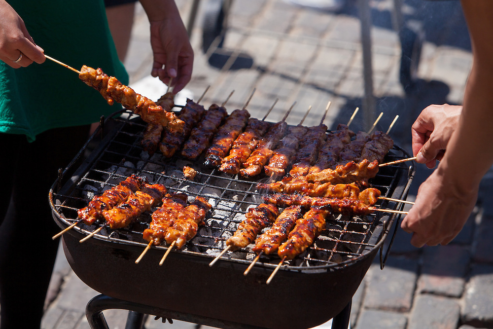 Chicken Satay is cooked up during the street fair celebrating International Week at Ohio University.  Photo by Ohio University / Jonathan Adams
