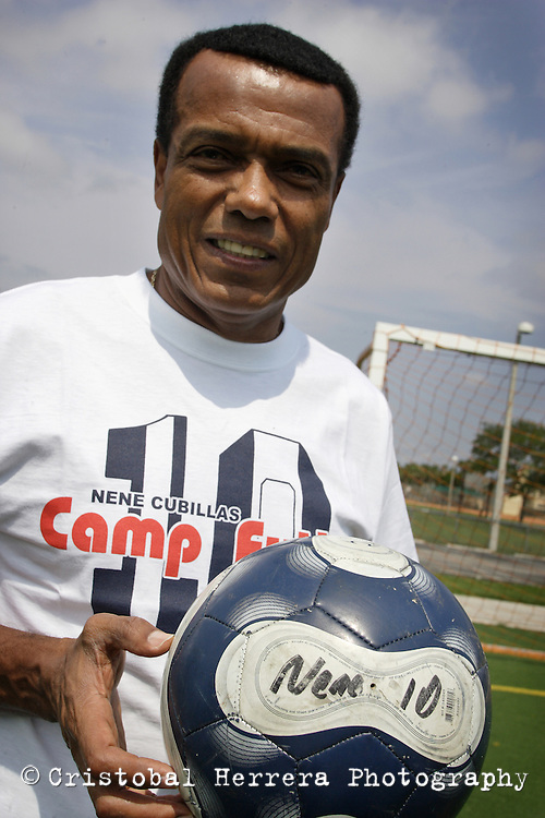 """Peuvian former soccer champion, Teofilo Cubillas, nicknamed """"El Nene Cubillas"""", poses with a ball at Coral Spring City Park on Wednesday June 24, 2009.  Staff photo/Cristobal Herrera.."""