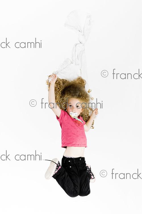 caucasian cute little girl holding blanket isolated studio on white background