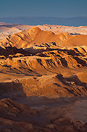 Early morning sunshine lights the rugged Valley of the Moon in the Atacama Desert in northern Chile.