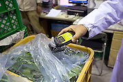 Signs of recovery in Miyagi Prefecture, Japan on 01 Dec., 2011. .Photographer: Robert GilhoolyA company employee explains the radiation testing system employed by  Butai Farm in Sendai, Japan on December 01, 2011.  The company was established as Butai Farm in 2003 with the idea of developing a company that would work on the whole farming process -- from production to processing, distribution, and sales. The March 11 tsunami flooded about 60% of the company's 40-hectare farmland. While working toward the reconstruction of the land, they have also introduced a three-tier radiation testing system in an attempt to recover consumer confidence..Photographer: Robert Gilhooly