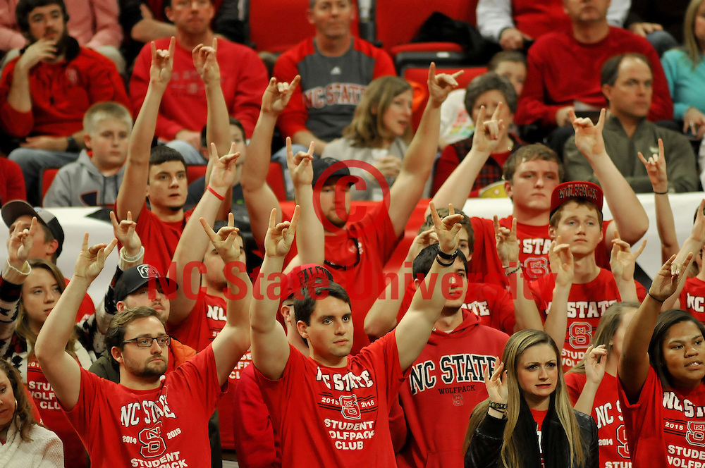 Wolfpack fans hold up their Wolf Hands during free throws.