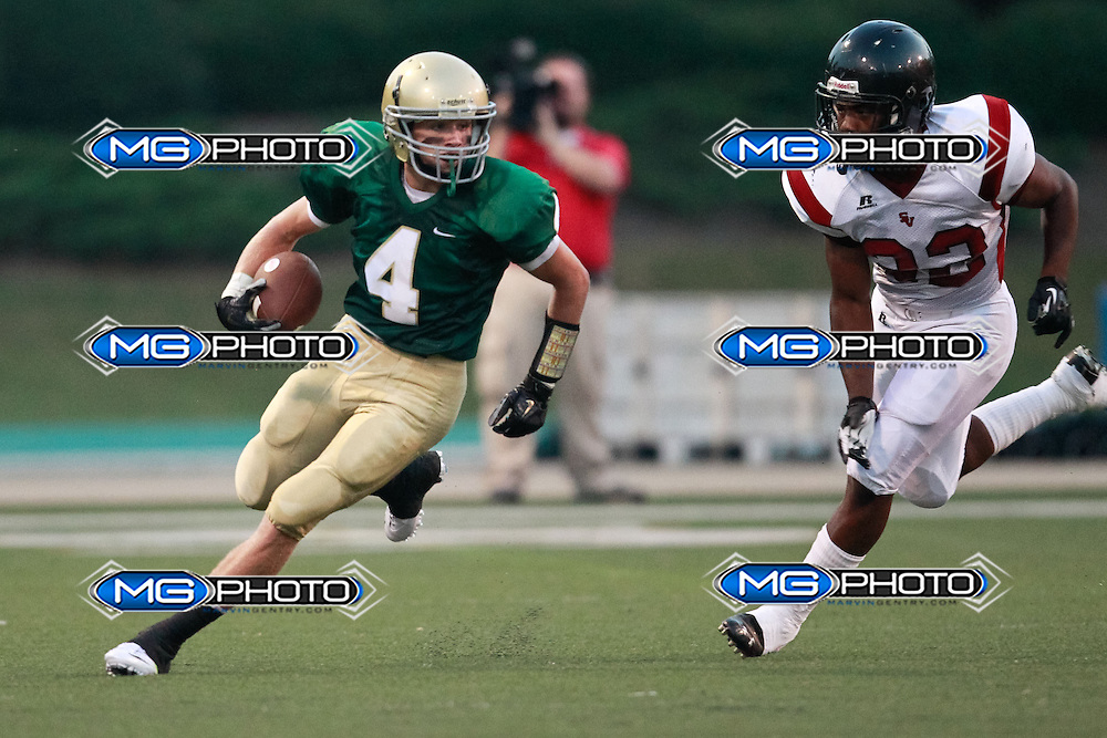 Sep 6, 2013; Mountain Brook, AL, USA; Mountain Brook's Drew Odum (4) attempts to out run a Shades Valley defender. Mandatory Credit: Marvin Gentry