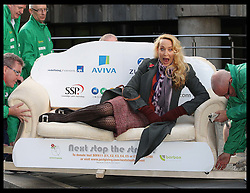Jerry Hall is hoisted up on a sofa at the end of a 10 mile sofa carrying walk to raise money for the homelessness charity Emmaus in London, Thursday, 17th November 2011. The former supermodel is patron of the charity.  Photo by: Stephen Lock / i-Images
