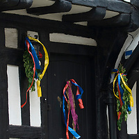 Tudor buiding door decorated with colourful ribbons in Hastings, West Sussex, England