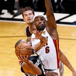 Jun 6, 2013; Miami, FL, USA; San Antonio Spurs point guard Tony Parker (9) lays the ball up as he is defended by Miami Heat small forward LeBron James (6) in the first quarter during game one of the 2013 NBA Finals at the American Airlines Arena. Mandatory Credit: Derick E. Hingle-USA TODAY Sports