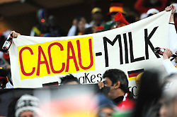 A German fan holds up a banner during the 2010 FIFA World Cup South Africa Group D match between Ghana and Germany at Soccer City Stadium on June 23, 2010 in Johannesburg, South Africa.