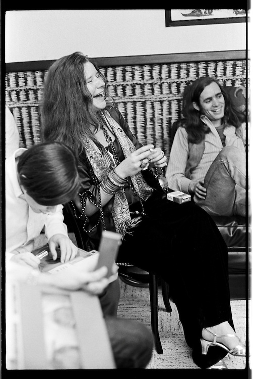 1960's American singer - songwriter Janis Joplin relaxes backstage at Cincinnati Music Hall before taking the stage in 1968. Janis died of a heroin overdose in 1970.<br /> Janis Lyn Joplin; January 19, 1943 &ndash; October 4, 1970 was an American singer-songwriter who first rose to fame in the late 1960s as the lead singer of the psychedelic-acid rock band Big Brother and the Holding Company, and later as a solo artist with her own backing groups, The Kozmic Blues Band and The Full Tilt Boogie Band. Her first ever large scale public performance was at the Monterey Pop Festival; this led her to becoming very popular and one of the major attractions at the Woodstock festival and the Festival Express train tour. Joplin charted five singles; other popular songs include: &quot;Down on Me&quot;; &quot;Summertime&quot;; &quot;Piece of My Heart&quot;; &quot;Ball 'n' Chain&quot;; &quot;Maybe&quot;; &quot;To Love Somebody&quot;; &quot;Kozmic Blues&quot;; &quot;Work Me, Lord&quot;; &quot;Cry Baby&quot;; &quot;Mercedes Benz&quot;; and her only number one hit, &quot;Me and Bobby McGee&quot;.  She was inducted into the Rock and Roll Hall of Fame in 1995.