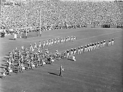 Kerry and Galway parade onto the pitch lead by the Artane Boys Band before the start of the All Ireland Senior Gaelic Football Championship Final, Kerry vs Galway in Croke Park on the 27th September 1959. Kerry 3-7 Galway 1-4.