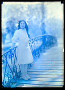 fading portrait of young girl standing on a bridge France circa 1920s
