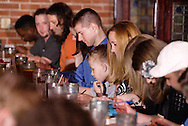 """Audience members during Mayhem & Mystery's production of """"Fashion Friction"""" at the Spaghetti Warehouse in downtown Dayton, Monday, March 21, 2011."""