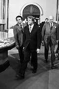 President Jimmy Carter flanked by his Ambassador to the United Nations, Andrew J. Young (left), walk into a meeting at The Smithsonian Institution's Castle building. 1978 - To license this image, click on the shopping cart below -