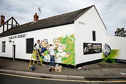 Street Artists paint a Scotland v Japan mural on the Coach and Horses pub near Kingsholm Stadium before the match - Mandatory byline: Rogan Thomson/JMP - 07966 386802 - 23/09/2015 - FOOTBALL - Bescot Stadium - Walsall, England - Walsall v Chelsea - Capital One Cup.