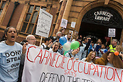 London, UK 9th April 2016: Campaigners against the closure by Lambeth council  of Carnegie Library in Herne Hill, south London, emerge from the premises into the street on their 10th day of occupation, 9th April 2016. The local community have been occupying their important resource for learning and social hub and after a long campaign, Lambeth have gone ahead and closed the library's doors for the last time because they say, cuts to their budget mean millions must be saved. They plan to re-purpose it into a gym although details are unknown.