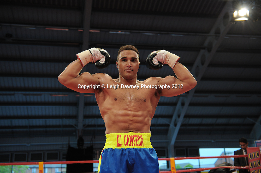 Louis Cuddy defeats Jozef Kusmirek in a 4x3 Cruiserweight contest at the Aintree Equestrian Centre, Liverpool on the 19th May 2012. Frank Maloney Promotions © Leigh Dawney Photography 2012.Louis Cuddy (blue & yellow shorts) defeats Jozef Kusmirek in a 4x3 Cruiserweight contest at the Aintree Equestrian Centre, Liverpool on the 19th May 2012. Frank Maloney Promotions © Leigh Dawney Photography 2012.