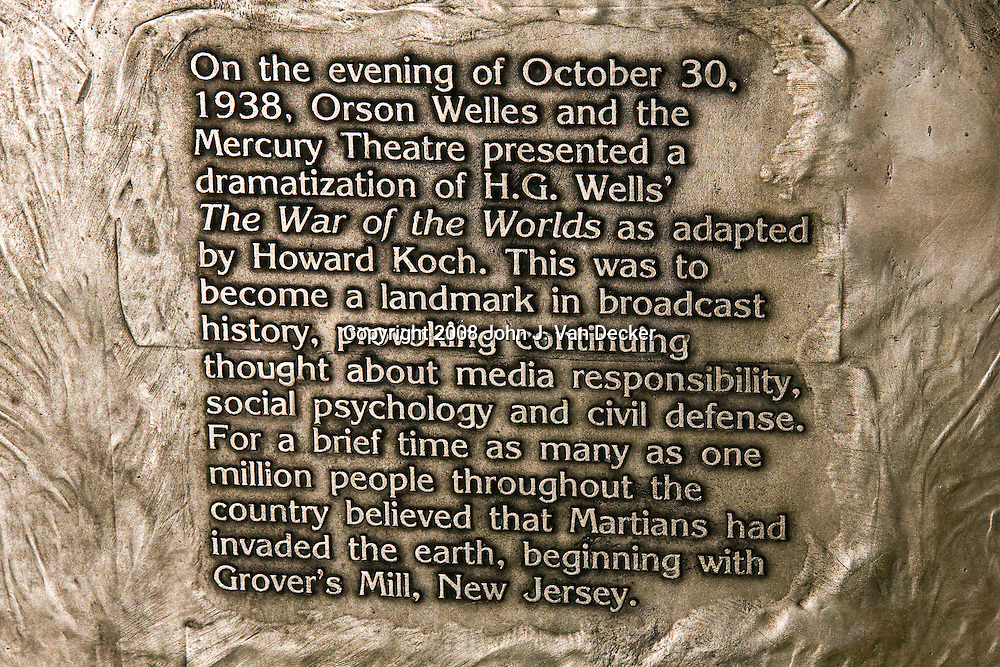 "1938 Martian Landing Site Monument. Detail of verbiage.......Monument commemorates Orson Welles' famous broadcast of a radio adaptation of H.G.Wells' ""War of the Worlds"" in which a Martian invasion force landed at Grovers Mill, New Jersey. The broadcast was initially believed to be true by many."