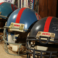 Chuck Hankins owns Ole Miss football hements with coaches signatures dating back to Tommy Tuberville in the 1990's