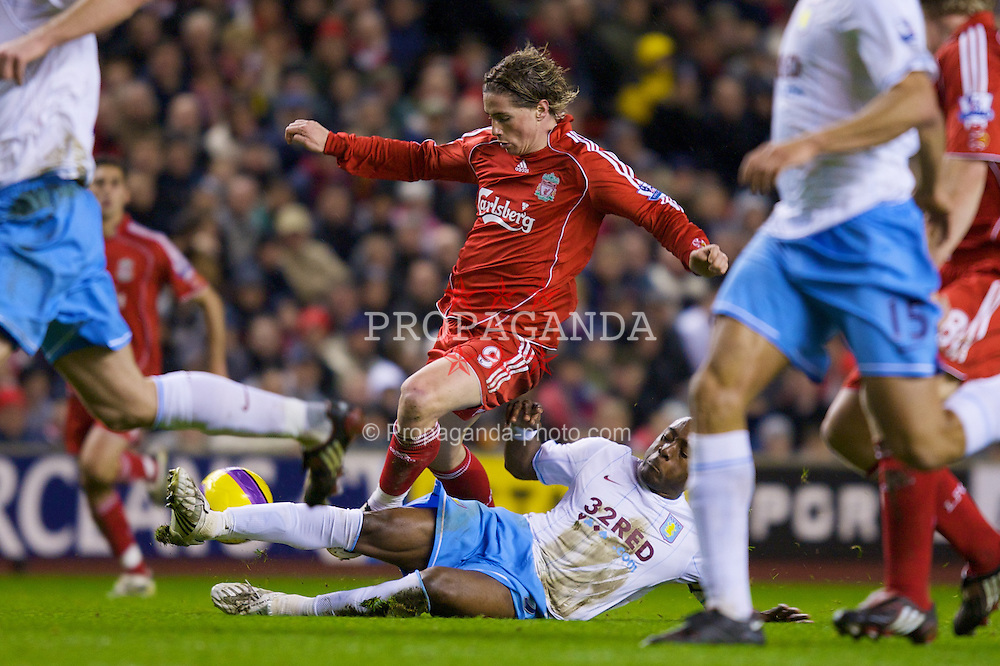 LIVERPOOL, ENGLAND - Monday, January 21, 2008: Liverpool's Fernando Torres and Aston Villa's Nigel Reo-Coker during the Premiership match at Anfield. (Photo by David Rawcliffe/Propaganda)