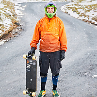 A portrait photograph of a skateboarder during the beast from the east in The Lake District, Cumbria, England