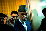 Security forces watch as Afghan President Hamid Karzai delivers his five year plan for the country in Kabul, Afghanistan, August 10, 2009. Karzai faces over 40 candidates challenging him in the presidential election to be held on August 20.Photo By Keith Bedford