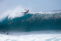 Surfer crashing a north shore banzai pipeline beach wave on the famous surfing North shore of Oahu, Hawaii.