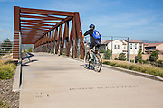 Biking over a Pedestrian Bridge at Irvine Boulevard and Jeffery in Irvine