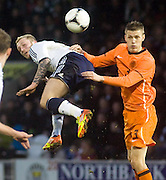 Scotland's Johnathon Russell and Holland's Jeffrey Gouweleeuw - Scotland v Holland - UEFA U21 European Championship qualifier at St Mirren Park..© David Young - .5 Foundry Place - .Monifieth - .Angus - .DD5 4BB - .Tel: 07765 252616 - .email: davidyoungphoto@gmail.com.web: www.davidyoungphoto.co.uk