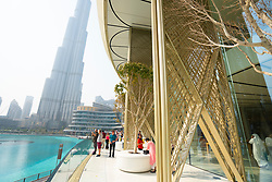 Balcony of Apple Store in Dubai Mall overlooking pond and Burj Khalifa in Dubai, UAE, United Arab Emirates