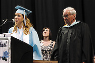 Kayla Hill, president of the Class of 2012 (left) speaks during a special presentation to retiring principal Robert Cotter during the Fairborn High School commencement at the Nutter Center in Fairborn, Friday, May 25, 2012.