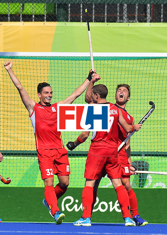 Belgium's Cedric Charlier (R) celebrates scoring a goal with teammates during the men's field hockey Belgium vs Britain match of the Rio 2016 Olympics Games at the Olympic Hockey Centre in Rio de Janeiro on August, 6 2016. / AFP / Carl DE SOUZA        (Photo credit should read CARL DE SOUZA/AFP/Getty Images)