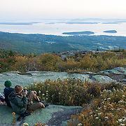 Tourists photographing sunrise from the top of Cadillac Mountain, the first place to see sunrise in the United States