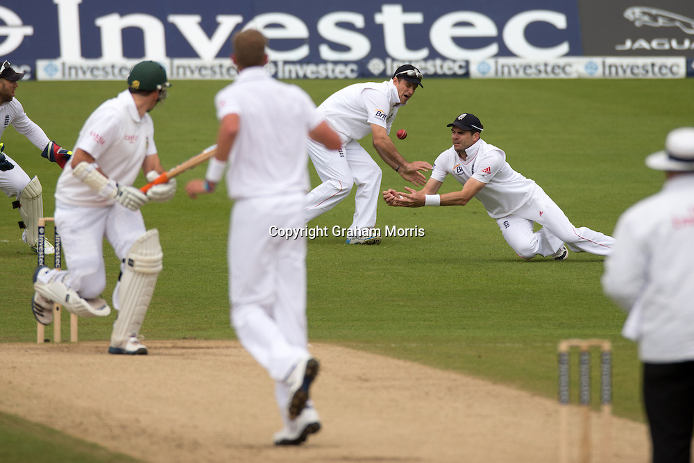 James Anderson, right, (watched by Andrew Strauss) doesn't stop a Jacques Rudolph edge off Stuart Broad during the second Investec Test Match between England and South Africa at Headingley, Leeds. Photo: Graham Morris (Tel: +44(0)20 8969 4192 Email: sales@cricketpix.com) 06/08/12