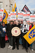 """Chris Coltrane and Jonnie Marbles of UK Un-Cut  along with PCS   and War on Want present George Osbourne with the Jammy """"Tax' Dodger award. He won the False economy top ten tax shrieker vote by a majority of 1158 votes. Sadly he could not attend to receive his award."""