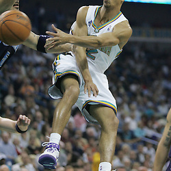 New Orleans Hornets guard Jannero Pargo #2 passes the ball past Carlos Boozer #5 of the Utah Jazz in the second quarter of their NBA game on April 8, 2008 at the New Orleans Arena in New Orleans, Louisiana.