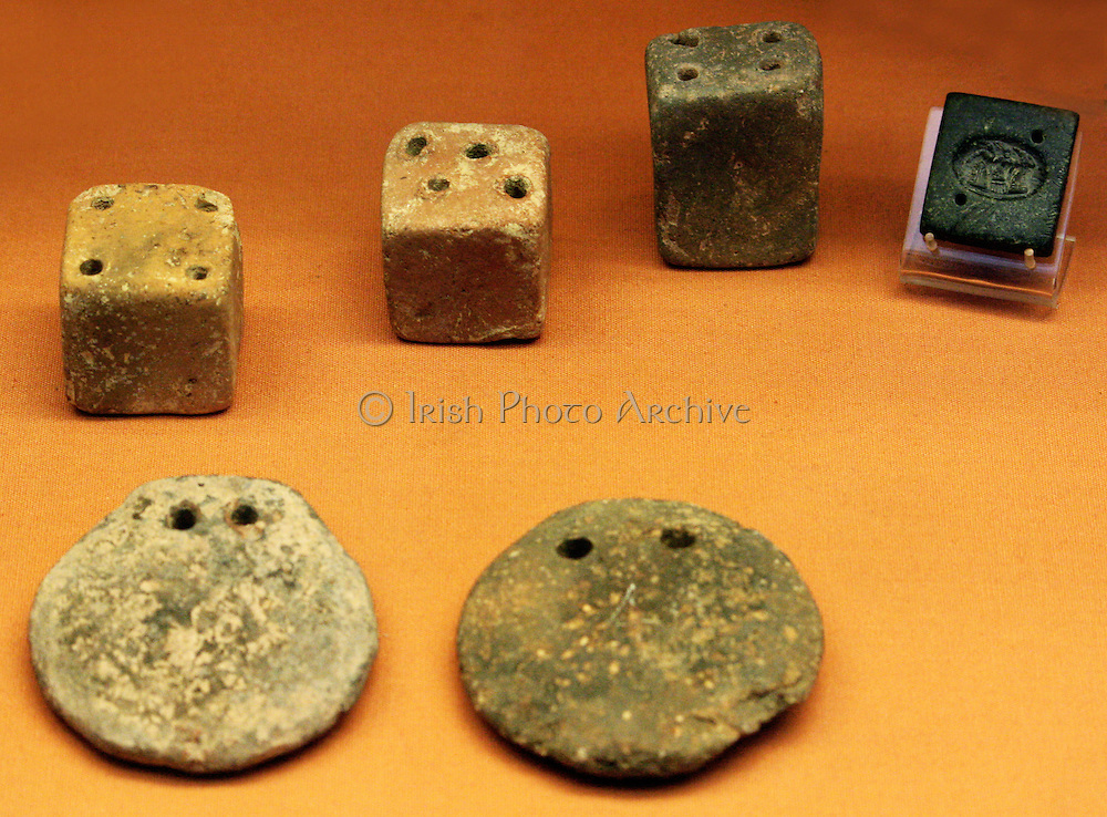 Six loon-weights, three disc-shaped and three cubes. Minoan 2100-1450 BC Found at Petras and Palaikastro